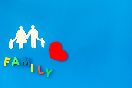 Family copy and adoption child concept on blue table background top view mockup