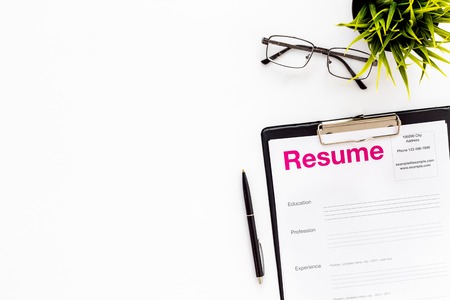 Review resumes of applicants set with glasses on white work desk background top view mockup