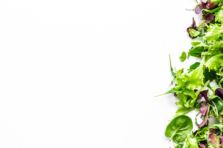 Green and red salad mix for healthy food on white background top view mock up