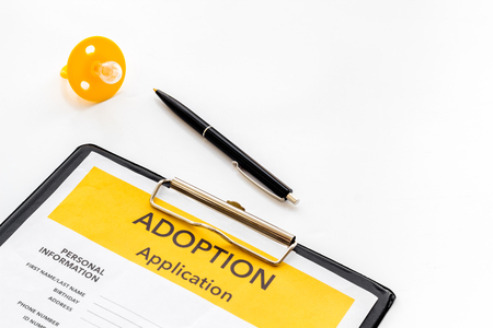 Application to adopt child with dummy on white background