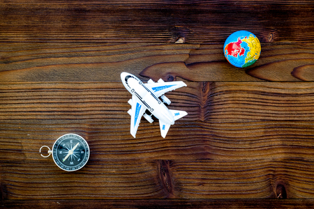 SOS Save the planet and eco concept with the earth, plane and compass on wooden background flat lay mock-up