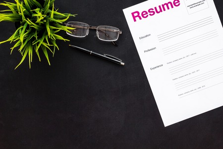 Review resumes of applicants set with glasses on black work desk background top view mockup