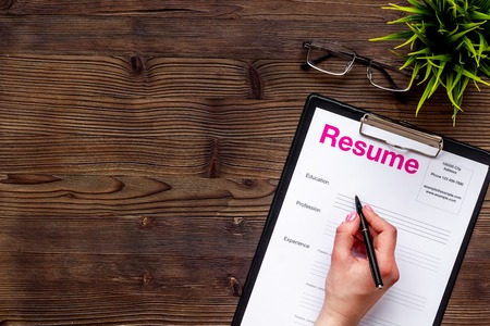 Review resumes of applicants set with glasses on wooden work desk background top view mockup