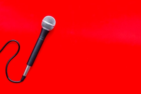 Podcast record with microphone on red background top view space for text Stock Photo