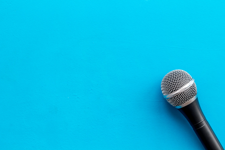 Blogger, journalist or musician office desk with microphone on blue background top view copyspace Stock Photo