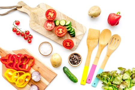Fresh food with raw vegetable ingredients for vegetarian kitchen on white background top view Stock Photo