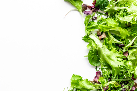 Fitness food cooking with organic green and red salad mix on white background top view copyspace