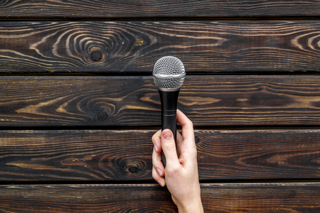 Podcast record with microphone on wooden office desk background top view space for text Stock Photo