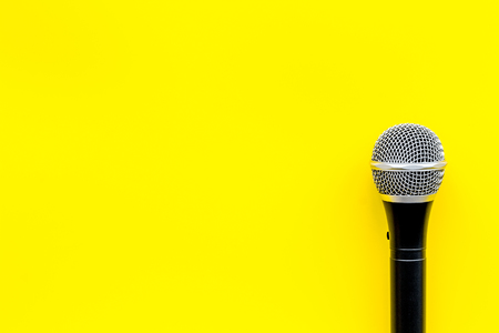 Podcast record with microphone on yellow office desk background top view space for text Stock Photo
