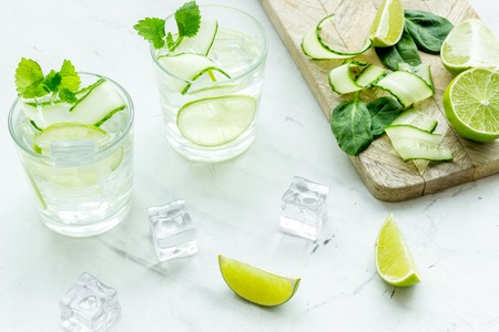 Healthy drinks with lime and ice for summer freshness on white background