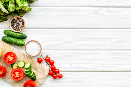 Cooking with raw vegetables on white wooden kitchen background top view mockup