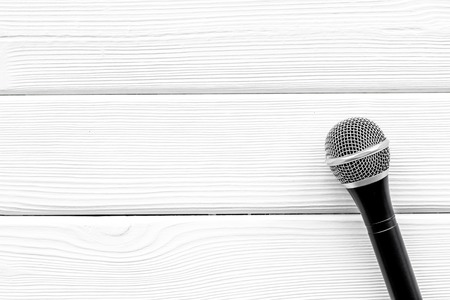 Microphone for blogger, journalist or musician work on white wooden background top view copyspace. Stock Photo