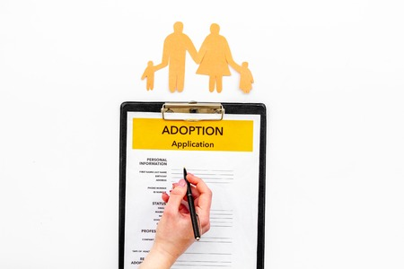 Children care and motherhood set with adoption application and family paper figure on white background top view