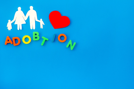 Family figure with adoption copy on blue background top view space for text