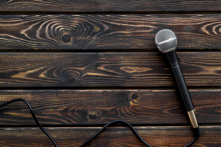 Microphone for blogger, journalist or musician work on wooden background top view copyspace. Stock Photo