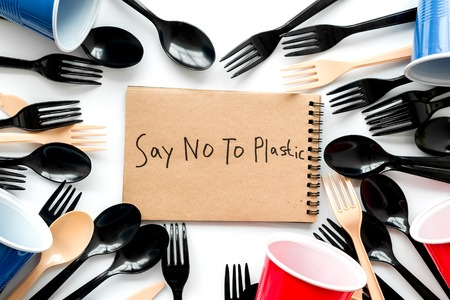 Say no to plastic copy. Planet protection. Eco concept and injunction on the use of plastic flatware on white background top view. Stock Photo