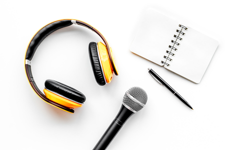 Record studio set. Blogger, journalist or musician work space with microphone, notebook and headphones on white background top view mockup Stock Photo
