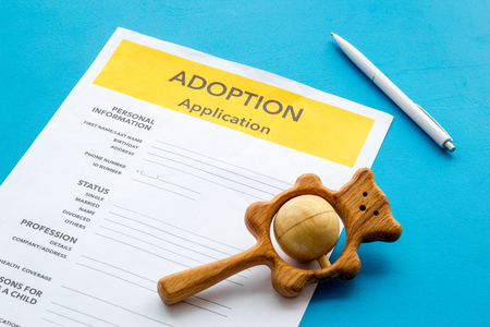 Family together concept. Application to adopt child with toy on blue background Stock Photo
