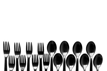 Eco and plastic utilization concept with flatware on white background top view mock up