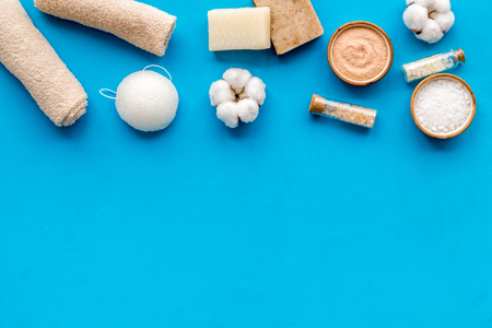 Organic cosmetics and eco-friendly materials for homemade natural spa and bath on blue background top view mock up