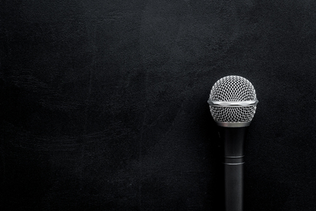 Podcast record with microphone on black office desk background top view space for text