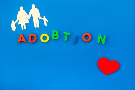 Family concept and adoption child copy on blue table background top view