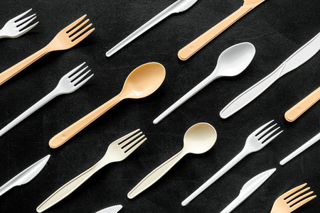Eco and plastic utilization concept with flatware on black background top view pattern Archivio Fotografico - 120118627