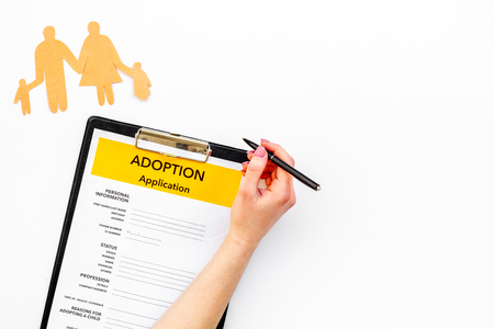 Application form for adopt child on white table background top view mock up