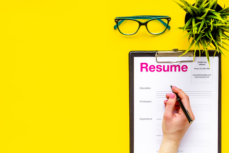 Review resumes of applicants set with glasses on yellow work desk background top view mockup