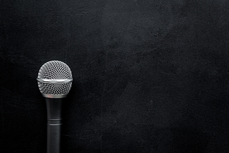 blogger, journalist or musician office desk with microphone on black background top view copyspace