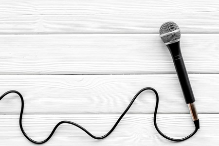 Podcast record with microphone on white office desk background top view space for text
