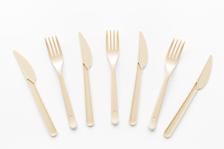 Go green. Plastic flatware for eco and Earth protection concept on white background top view Banco de Imagens