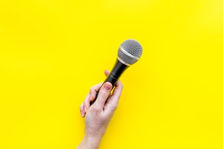 Record studio set. Blogger, journalist or musician work space with microphone on yellow background top view space for text Stock Photo