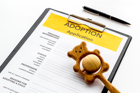 Application to adopt child with toy on white background 写真素材
