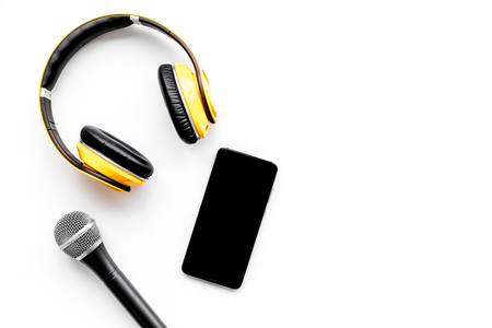 Microphone, headphones, mobile for blogger, journalist or musician work on white background top view mockup Stock Photo
