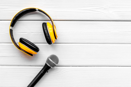 blogger, journalist or musician office desk with microphone and headphones on white background top view copyspace Stock Photo