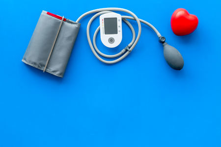 Diagnostics of cardiac disease and heart attack protection with pulsimeter on blue background top view copyspace Stok Fotoğraf
