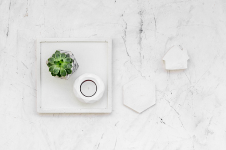 Work desk design with concrete decorations, candle and plant on marble background top view Zdjęcie Seryjne - 120861608