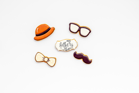 Bow tie, mustache, glasses and hat for Happy Father Day party on white background top view copy space