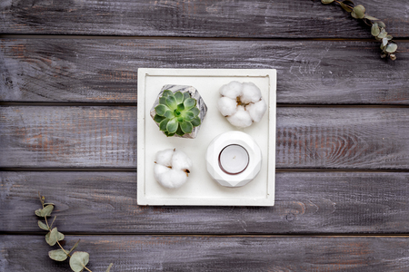 Work desk design with concrete decorations, candle and plant on wooden background top view 版權商用圖片