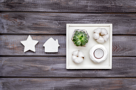Plant, concrete figures and tray decorations for modern home office design on wooden work desk background flat lay 版權商用圖片