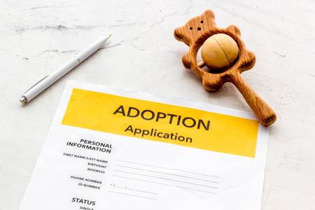 Children care with adoption application and toy on white office table background Stock Photo