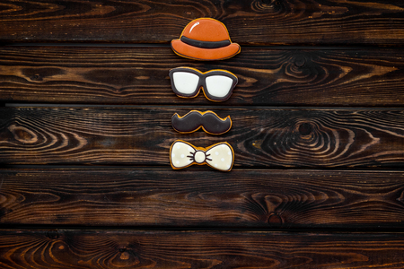Bow tie, moustache, glasses and hat for Happy Father Day party on wooden background top view copy space. Stock Photo