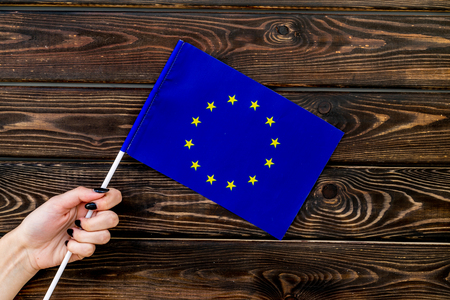 Flag of European Union on wooden background top view. Stock Photo