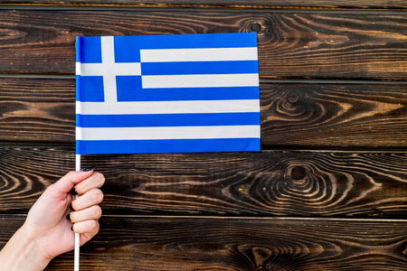 Flag of Greece on wooden background top view.