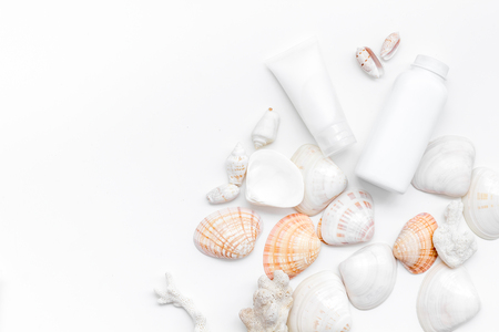 Spa organic cosmetics, cream, lotion with Dead Sea minerals and shells on white desk background flat lay space for text Archivio Fotografico - 121244814
