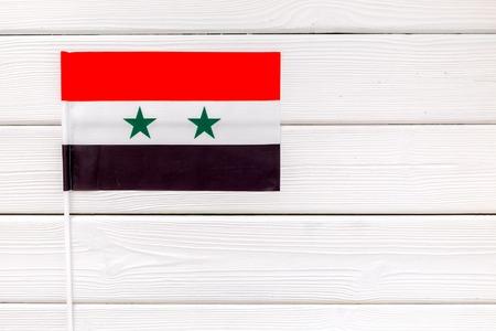 Flag of Syria on white wooden  top view. Stockfoto