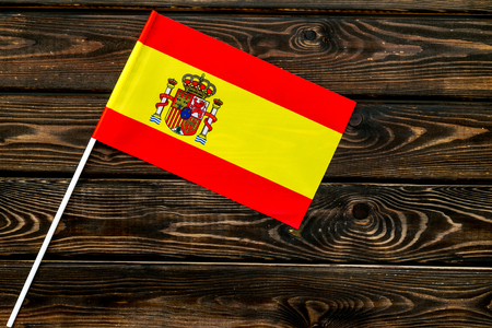 Flag of Spain on wooden background top view