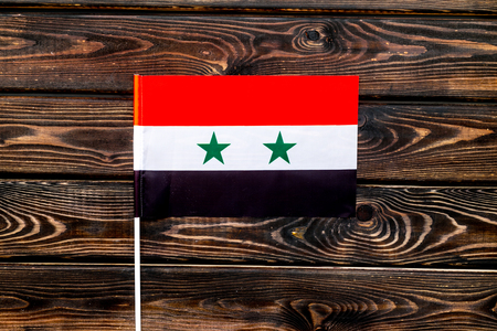 Flag of Syria on wooden background top view