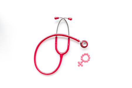 Stethoscope and female symbol for diagnostic and cure of gynaecological disease on white background top view
